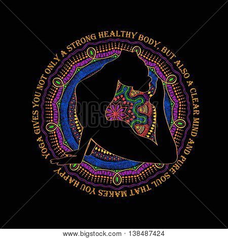 Isolated woman silhouette doing cobra pose of yoga and vibrant colorful mandala design on a black background.