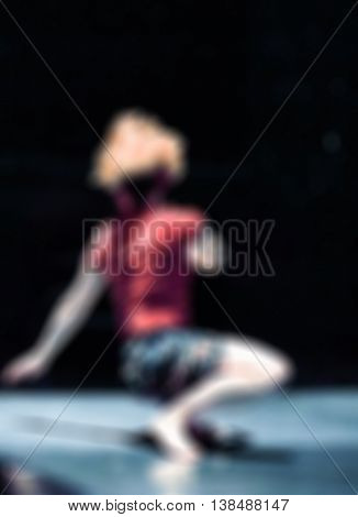 Contemporary dance performance abstract blur background with shallow depth of field