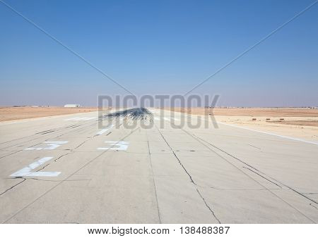 Riyadh - March 01:  Runway of the Riyadh King Khalid Airport on March 01, 2016 in Riyadh, Saudi Arabia. Riyadh airport is home port for Saudi Arabian Airlines.