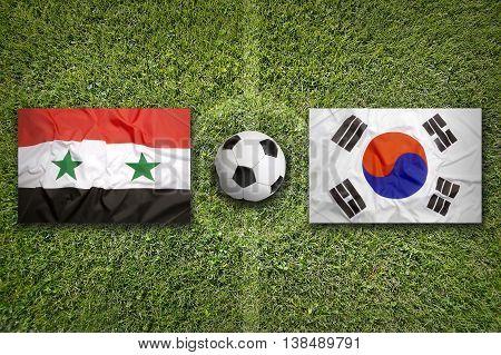 Syria Vs. South Korea Flags On Soccer Field