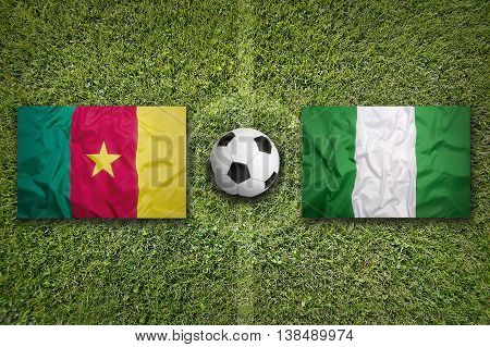 Cameroon Vs. Nigeria Flags On Soccer Field
