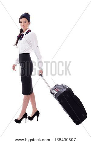 Young Stewardess Walking With Suitcase Isolated On White