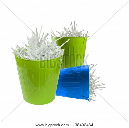 Three waste basket full with shredded paper