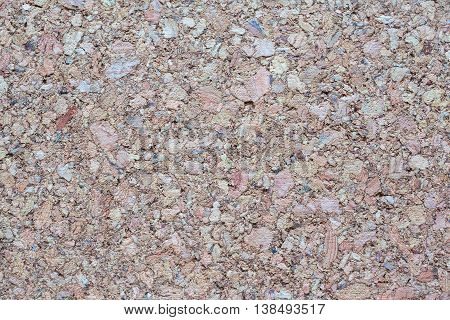 Texture of pressed wood dust board with disordered grain as background