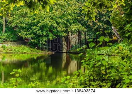 A green park with a lake and an ark in Berlin Germany.