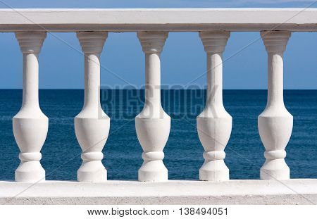 white balusters on sea and sky background.