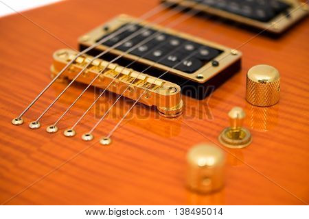Detail of Orange Electric Guitar Body with Strings