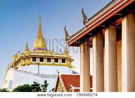The Golden Mount at Wat Saket. Golden Mount as known as Phu Khao Thong is now a popular Bangkok tourist attraction and has become one of the symbols of the city.