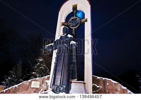 Monument Of St. Francis At Frozen Evening
