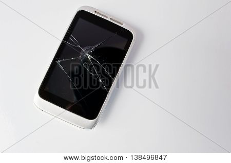 Broken Screen Of Smart Phone At White Background