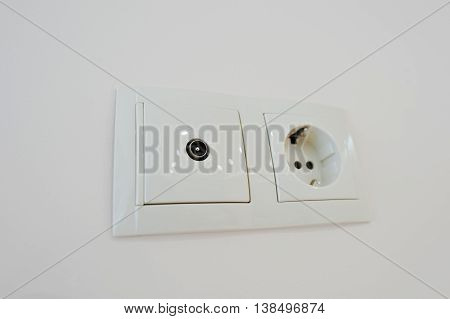 Twin Electric Socket With Tv Plug At The Wall