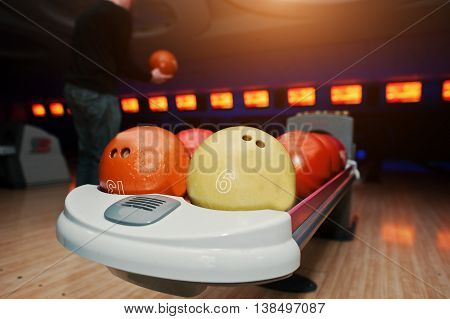 Bowling Balls At Bowl Lift With Ultraviolet Lighting Background Player
