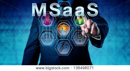 Business manager pushing MSaaS on a monitor. Business concept and information technology metaphor for Managed Software as a Service. Support staff cloud computing and security icon activated.