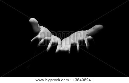 Praying Hands in black background hold hope