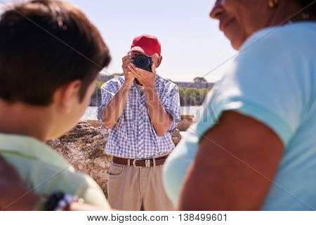 Family On Holidays In Cuba Grandpa Tourist Taking Photo