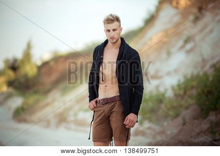 Portrait of young man in casual clothes. Blonde hair