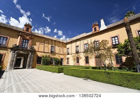 SEVILLE, SPAIN - September 12, 2015: View of the Patio del Crucero the garden that owes its name to its cross shape in Alcazar of Seville on September 12, 2015 in Seville, Spain