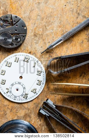 Various Horologists Tools With A Clock Dial