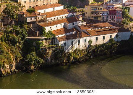 PORTO, PORTUGAL - JUL 12, 2016: View of Douro river and coast of Vila Nova de Gaia. City of Porto won the European Best Destination 2012 and 2014 awards.