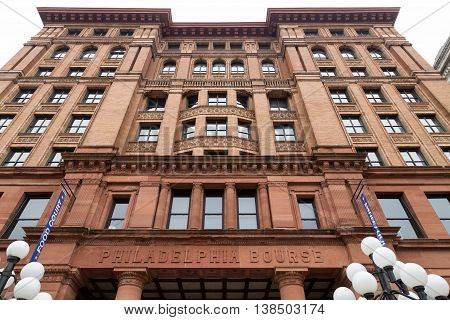 Philadelphia PA USA - November 19 2014. Facade of the Philadelphia Bourse Building viewed from below. Currently a tourist place the building houses shops and restaurants