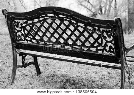 ice coated park bench winter blizzard solitary