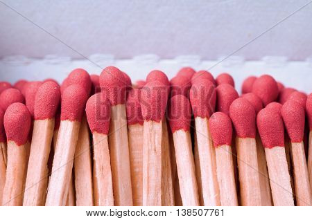 Close-up of red matches on white background
