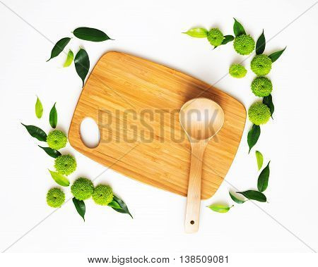 Wooden Cutting Board And Ladle With Decoration.