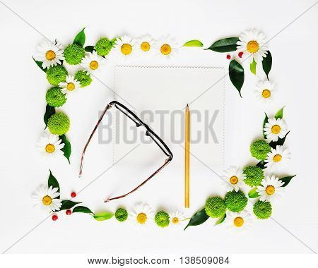 Paper, Pencil And Glasses With Wreath Frame.