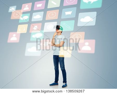 3d technology, virtual reality, entertainment, cyberspace and people concept - happy young man with virtual reality headset or 3d glasses thinking and looking at screen with menu icons