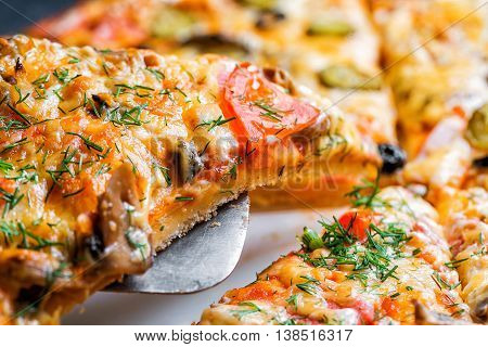Slice of Delicious fresh hot Pizza with mushrooms.