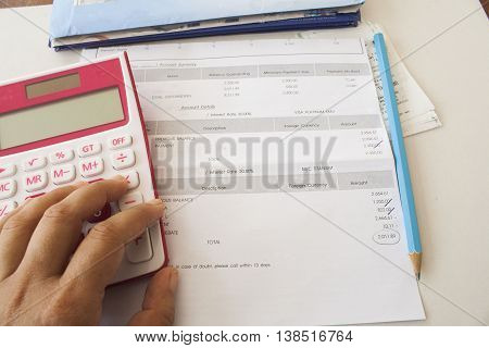 document monthly expenses credit card and finger to press calculator do accounts