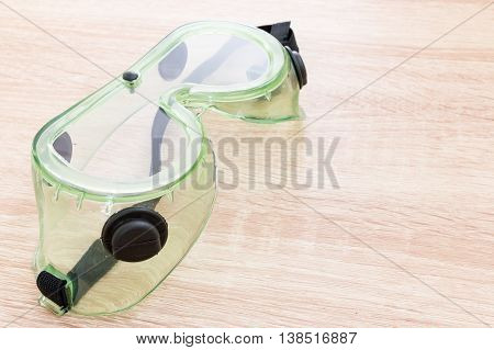 Safety Glasses On Wooden Background