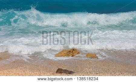 Tropical beach view, Greece, Lefkada. Detail of breaking waves on beach, Lefkada, Greece