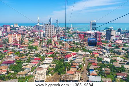 The cableway route shows the luxury districts scenic Black Sea coast lush forests and the old slums located behind the tourist areas Batumi Georgia.