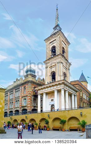 TBILISI GEORGIA - MAY 28 2016: The Neoclassic bell tower of Sioni Cathedral of the Dormition rises over the historical neighborhood on May 28 in Tbilisi.