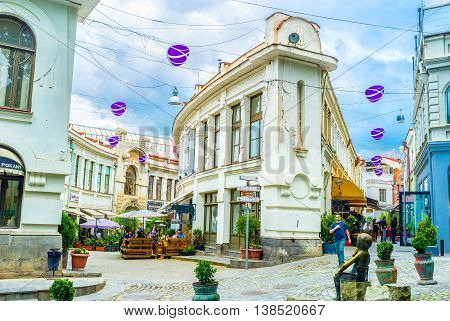 TBILISI GEORGIA - MAY 28 2016: The numerous taverns and wine houses located in twisted streets of old town on May 28 in Tbilisi.