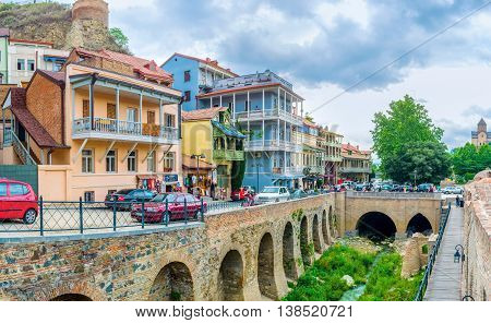 TBILISI GEORGIA - MAY 28 2016: The Abanotubani neighborhood is famous for the sulphur baths and colorful quarters with cafes and tourist stalls on May 28 in Tbilisi.