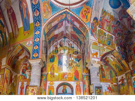 TBILISI GEORGIA - MAY 28 2016: The wide panorama of interior of Upper Bethlehem Church with frescoes depicting the Saints and Angels on May 28 in Tbilisi.