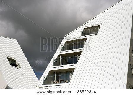 AARHUS DENMARK - JULY 13 2016: New modern architecture on Aarhus harbor. The buildings called The Iceberg. Aarhus will be European capital of culture in 2017. July 13 2016.