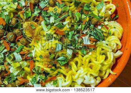 Bowl Of Instant Noodles With Pepper And Onion
