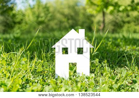 Cut Out Paper House On Green Grass