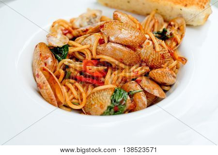 pasta or spaghetti clams with spicy chili sauce,thai food