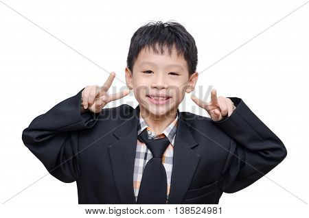 Young Asian boy in big suit over white