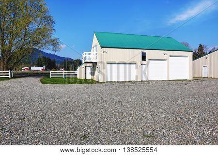 Separate Garage Building With Three Garage Doors