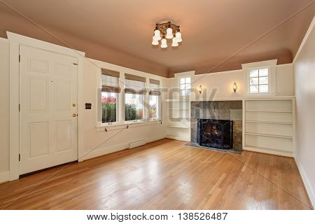 Empty Living Room Interior With Mocha Ceiling And Tile Trim Fireplace