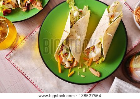 Two Khicken Fajitas On Green Plate Top View