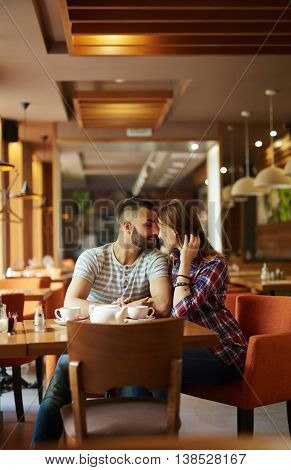 Amorous couple relaxing in cafe