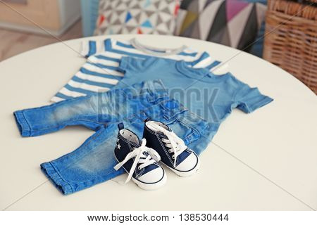 Baby clothes on a table, close up