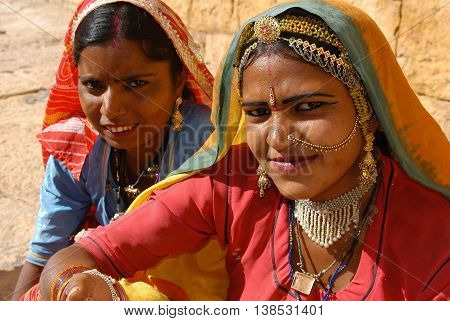 Jaisalmer, India - march 12, 2006: Women dressed in colorful costumes and jewelry of Rajasthan