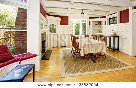 Bright Dining Room In Red Walls And White Wooden Trimmings.